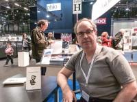 Robert Fred à la signature de Bourg-de-Four, au Salon du livre de Genève, 2015